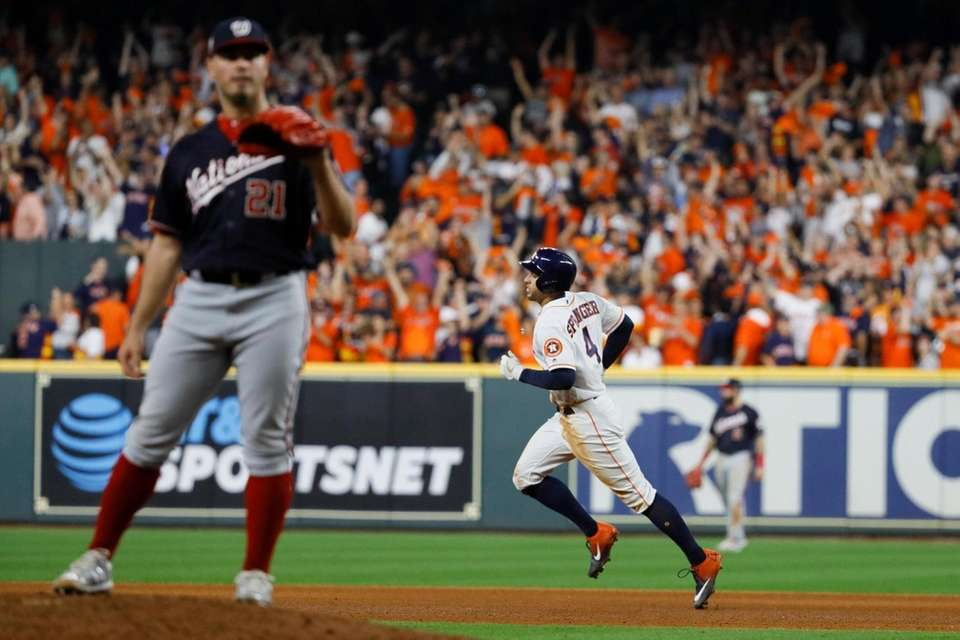 Houston Astros' George Springer rounds the bases after
