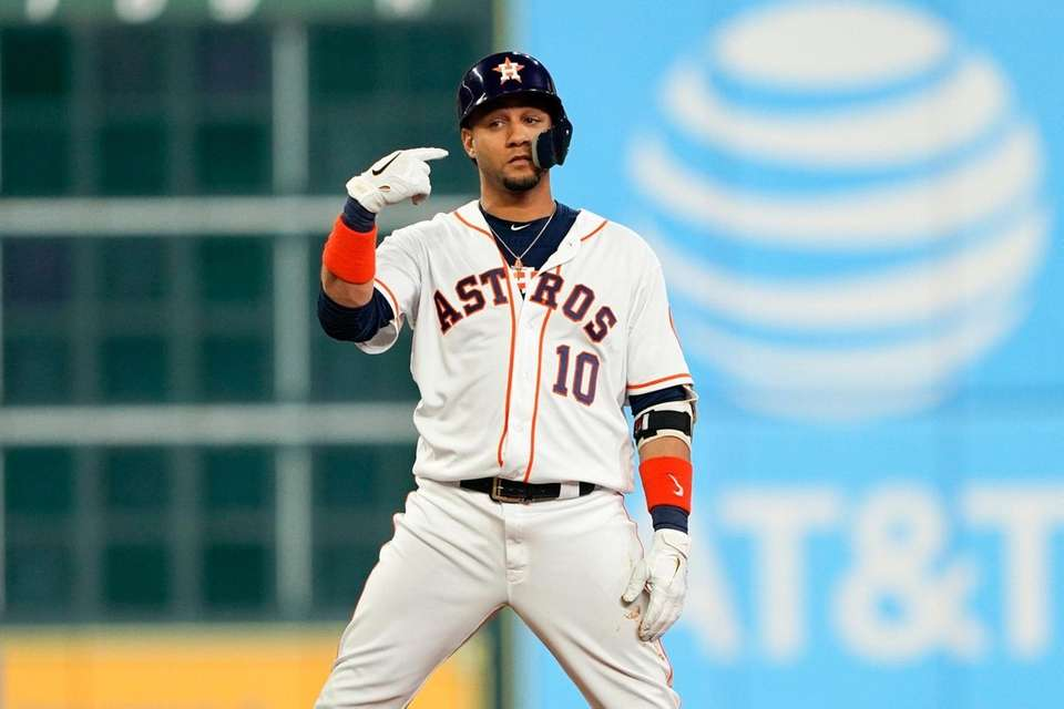 Houston Astros' Yuli Gurriel reacts after hitting a