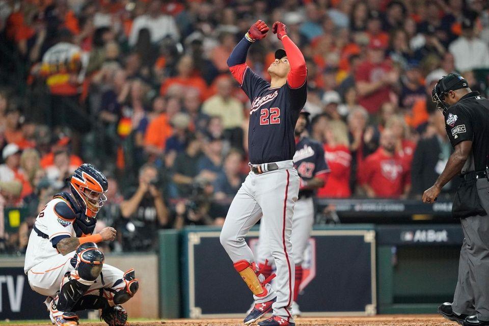 Washington Nationals' Juan Soto celebrates after hitting a