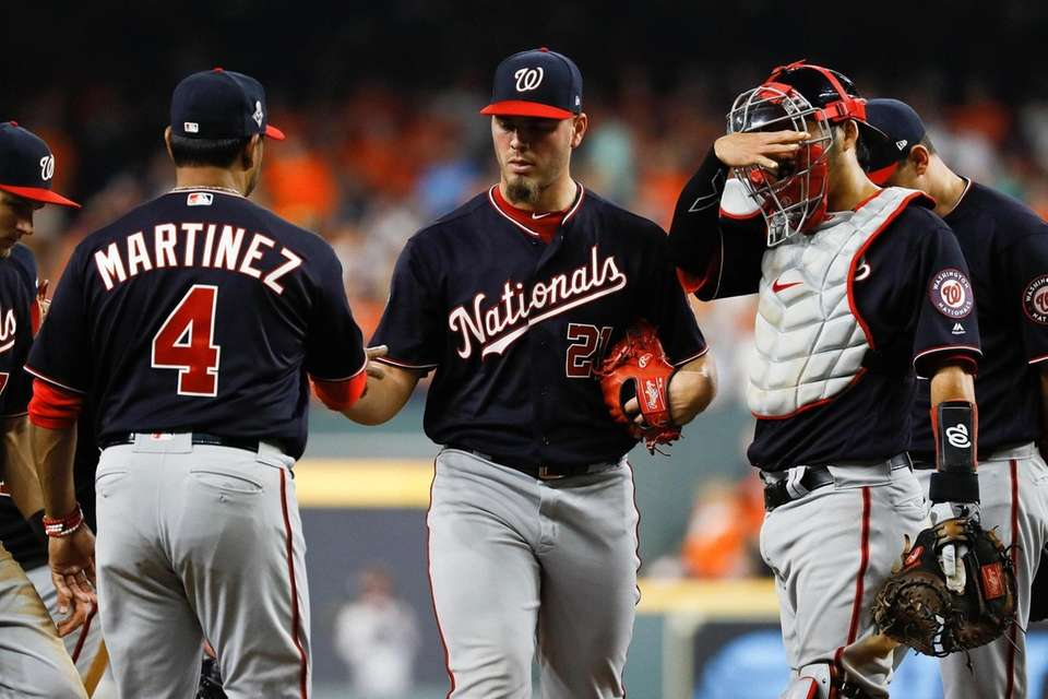 Washington Nationals manager Dave Martinez, left, takes relief