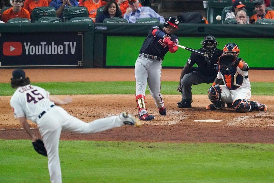 Washington Nationals' Juan Soto hits a home run
