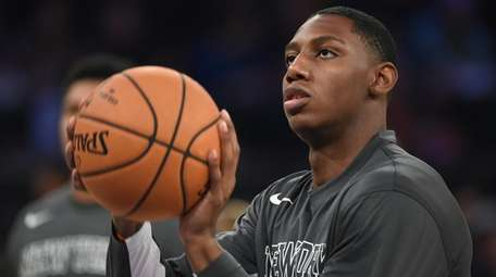 The Knicks' RJ Barrett warms up against the