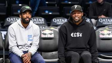 Nets guard Kyrie Irving (11) (left) and forward