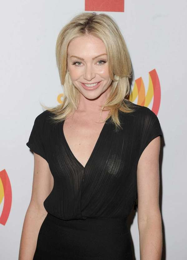 Actress Portia de Rossi poses backstage at the