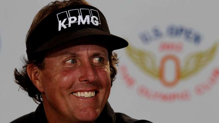Phil Mickelson speaks with the media during a