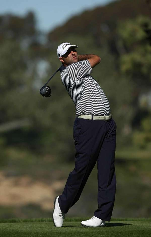 Marc Turnesa tees off the fifth hole during