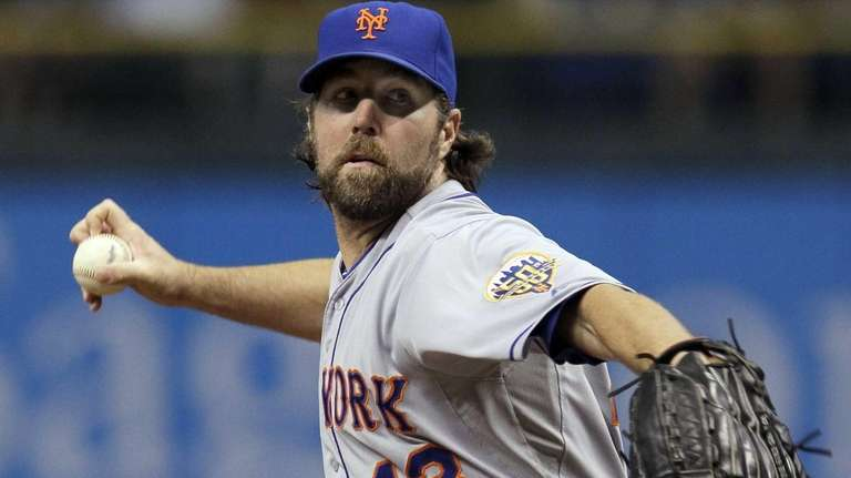 Mets starting pitcher R.A. Dickey delivers to the