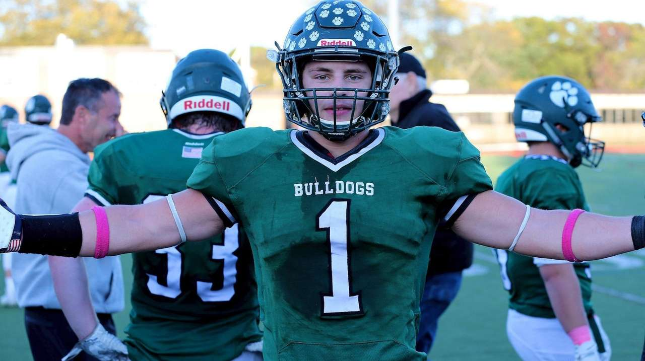Lindenhurst's Jack Winey celebrates his touchdown late in