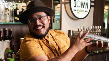 Jonathan Gonzalez behind the bar of Whiskey Down