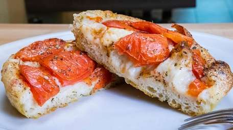 Focaccia with tomatoes at +39 Italian Eatery in