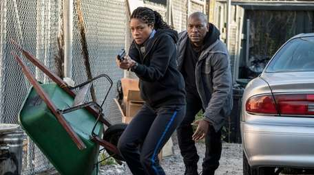 """Naomie Harris and Tyrese Gibson in """"Black and"""