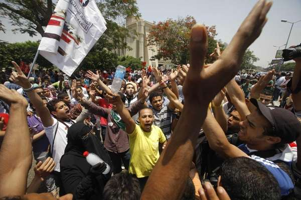 Egyptians shout anti-military slogans during a protest in