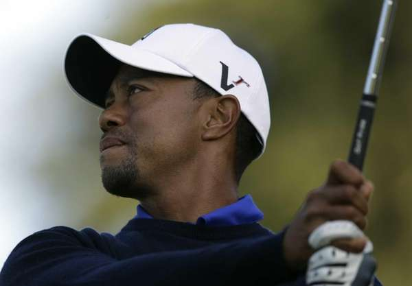 Tiger Woods hits a drive on the seventh