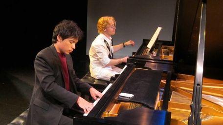 Christopher McKiggan, front, and Konstantin Soukhovetski perform at