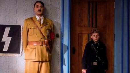 """Taika Waititi and Roman Griffin Davis in """"Jojo"""
