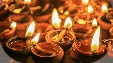 Diwali is celebrated by lighting lamps made of