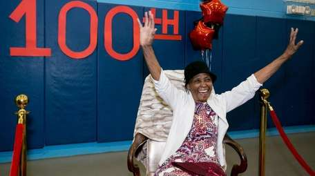 Ida Harris raises her hands for friends and