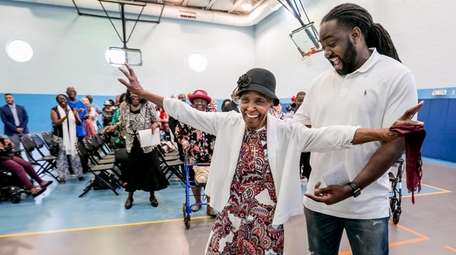 Ida Harris dances with her grandson Shaheed Stone