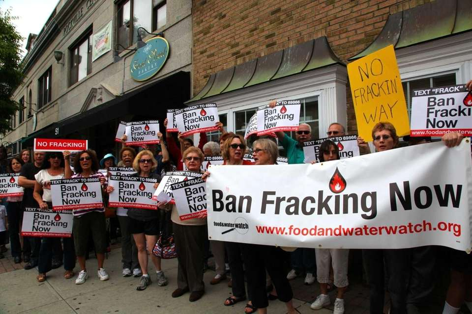 Gas-drilling opponents rally outside the office of Sen.