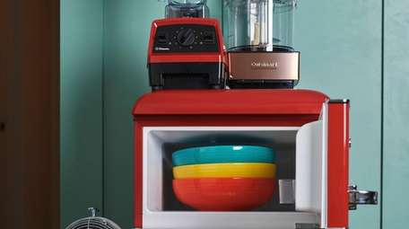 A variety of kitchen items in different colors,