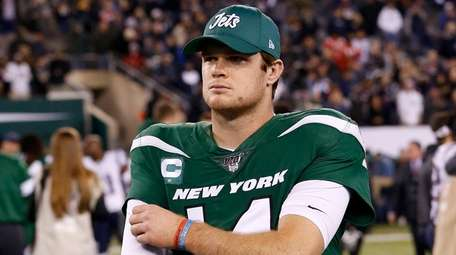 Sam Darnold of the Jets walks off the