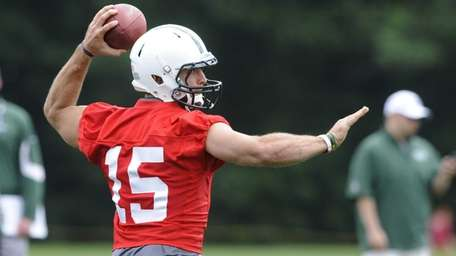 Jets quarterback Tim Tebow throws a pass during
