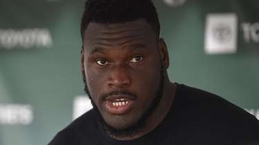 Jets guard Kelechi Osemele speaks with the media
