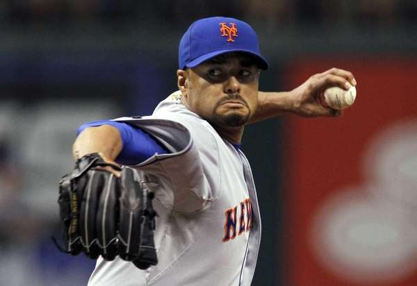 New York Mets starting pitcher Johan Santana delivers