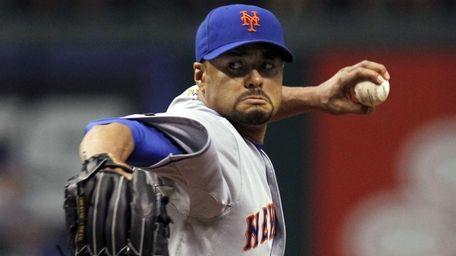 New York Mets starting pitcher Johan Santana delivers