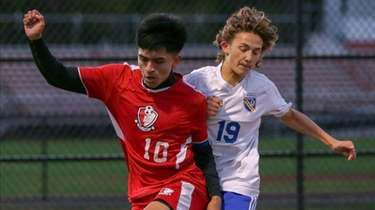 Bellport's Sam Gonzaga #10 and Comesewogue CJ Scricco