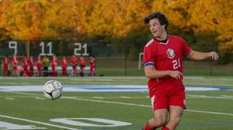 Bellport's Troy Zarba #21clears the ball against Comesewogue
