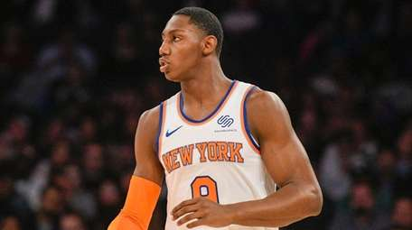 Knicks forward RJ Barrett dribbles downcourt in the