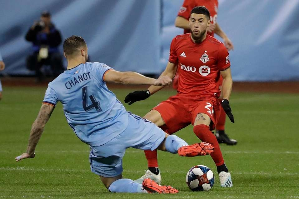 New York City FC's Maxime Chanot fights for