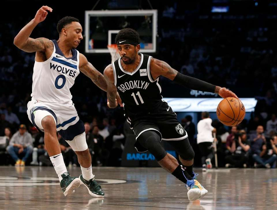 Kyrie Irving #11 of the Brooklyn Nets drives