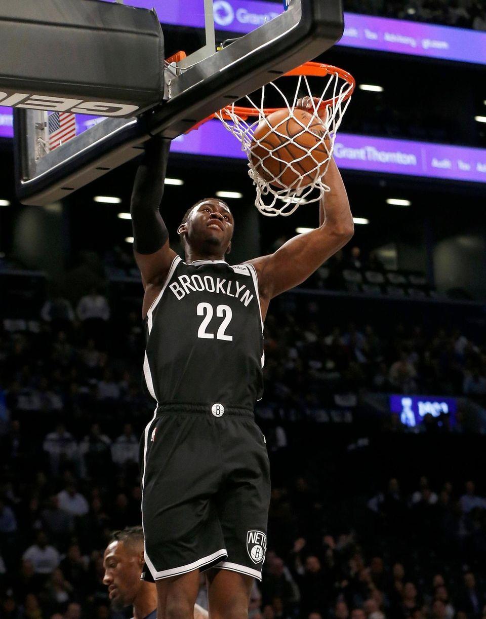 Caris LeVert #22 of the Brooklyn Nets dunks