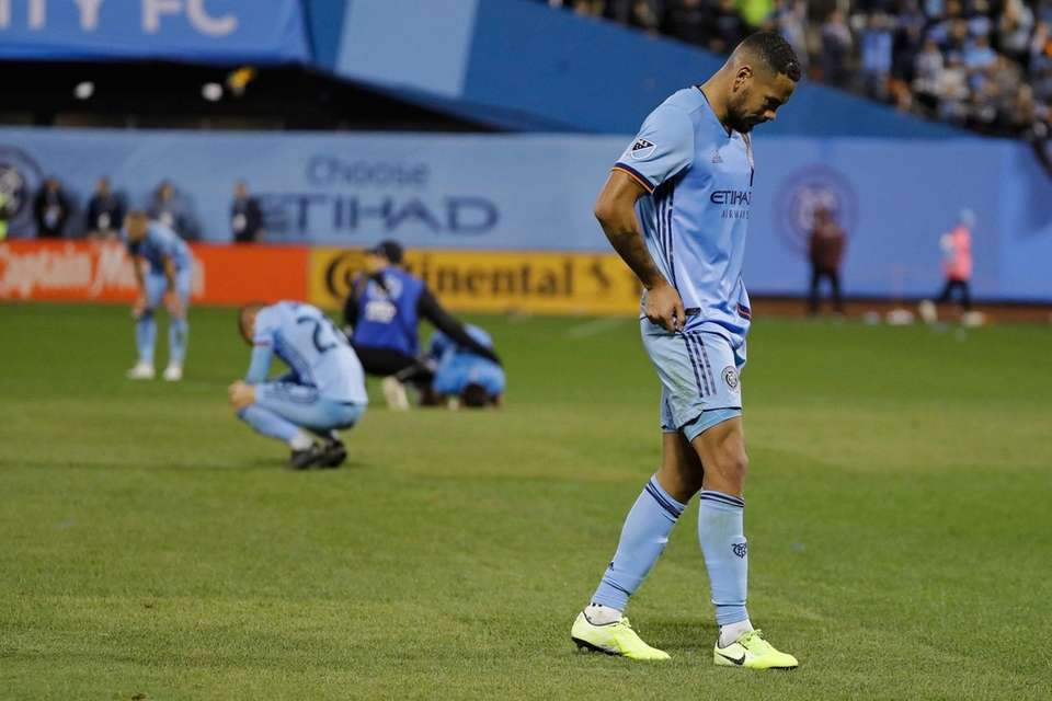 New York City FC's Alexander Callens, right, reacts