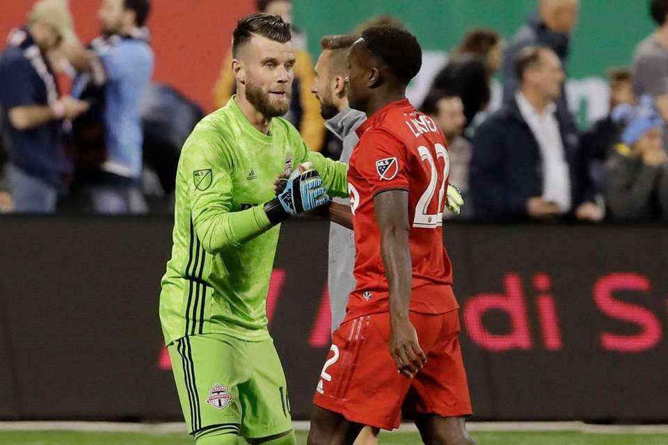 Toronto FC goalkeeper Quentin Westberg, left, and teammate