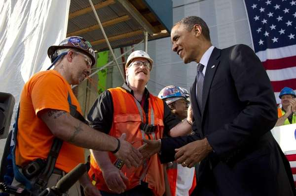 Workers greet President Barack Obama at the World