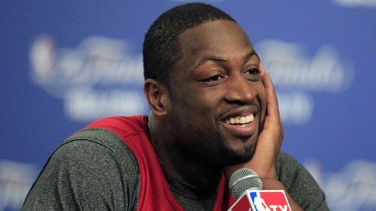 Miami Heat forward Dwyane Wade smiles during a