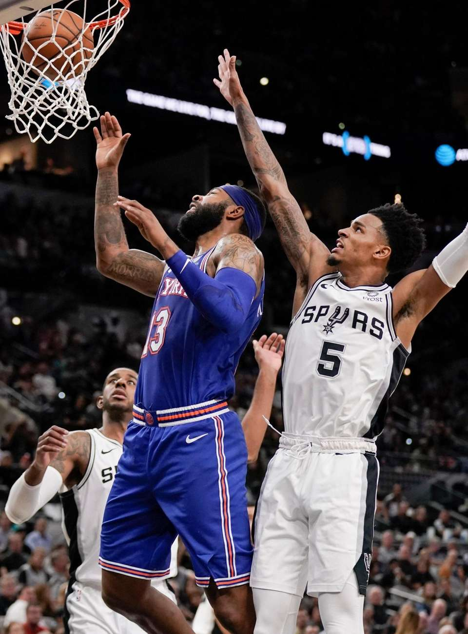 The Knicks' Marcus Morris scores as he is
