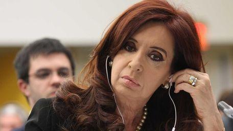 Argentina's President Cristina Fernandez de Kirchner listens during