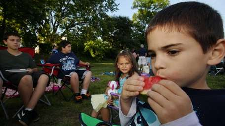 Danny Mallimo, right, 8, enjoys a little picnic