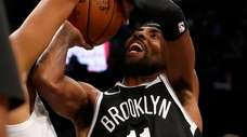 Kyrie Irving of the Nets attempts a shot