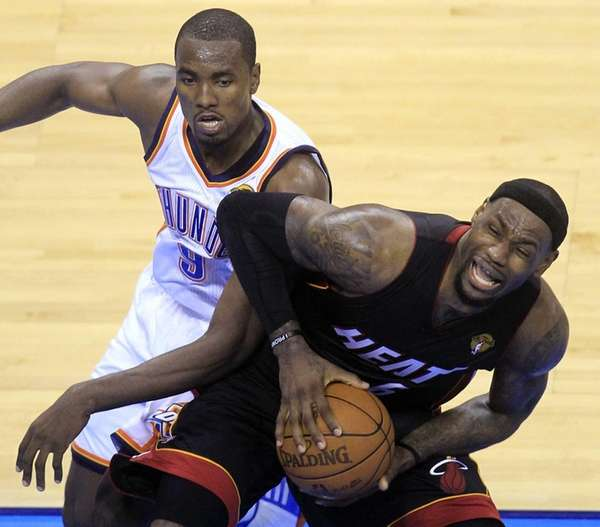 Miami Heat small forward LeBron James is defended