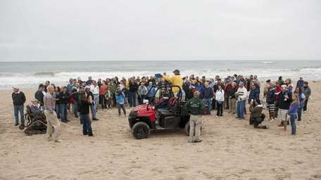 A crowd gathered to watch an reenactment of