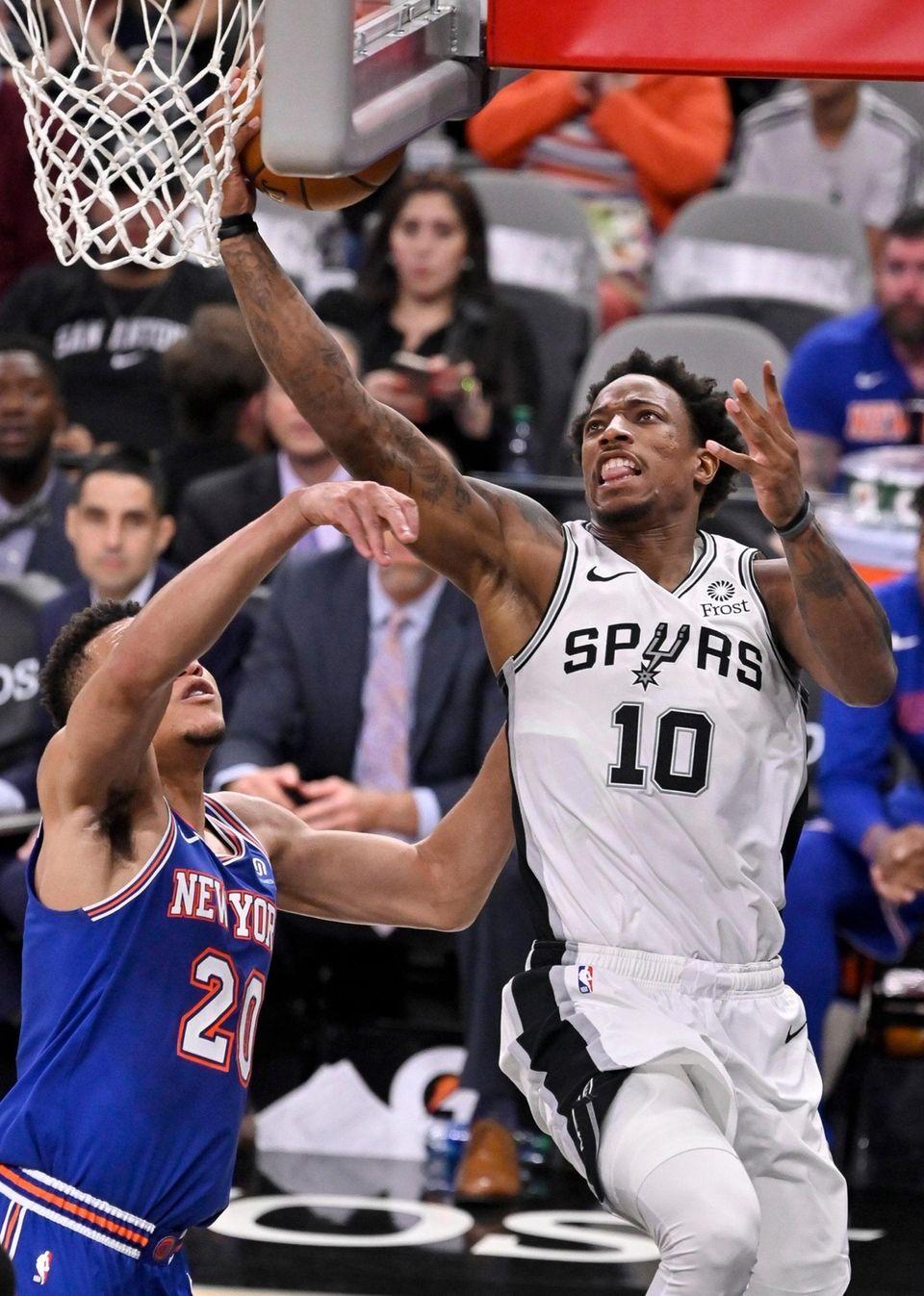 The San Antonio Spurs' DeMar DeRozan shoots against