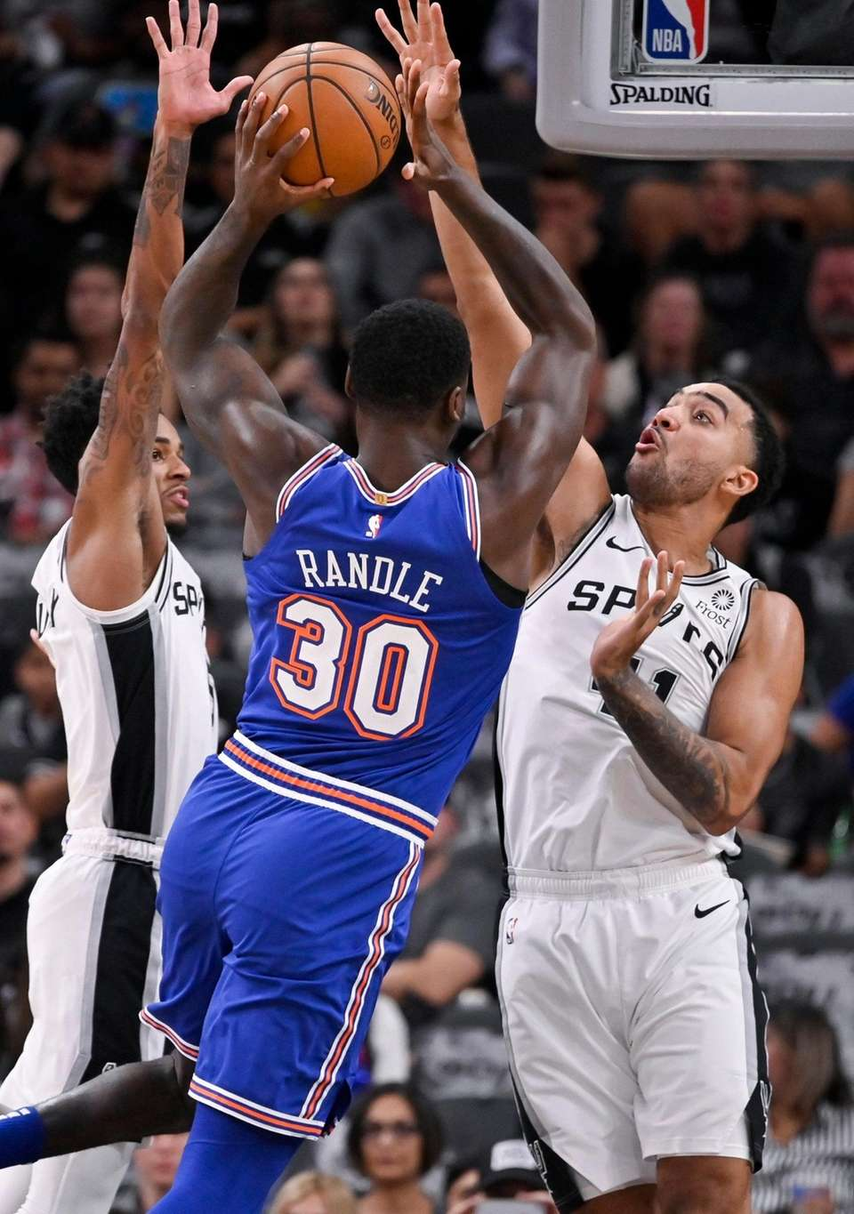 The Knicks' Julius Randle attempts to shoot against