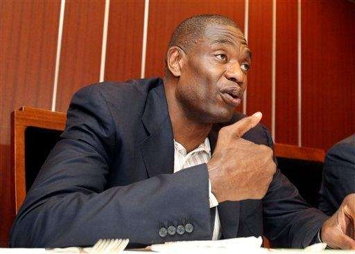 Former NBA star Dikembe Mutombo speaks during his