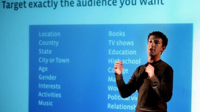 Chief executive and founder Mark Zuckerberg talks to