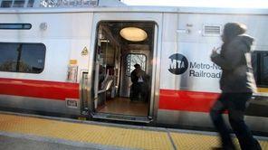 Passengers run to board a New York City
